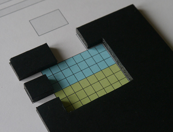 Foam-board pieces in position over the printed template