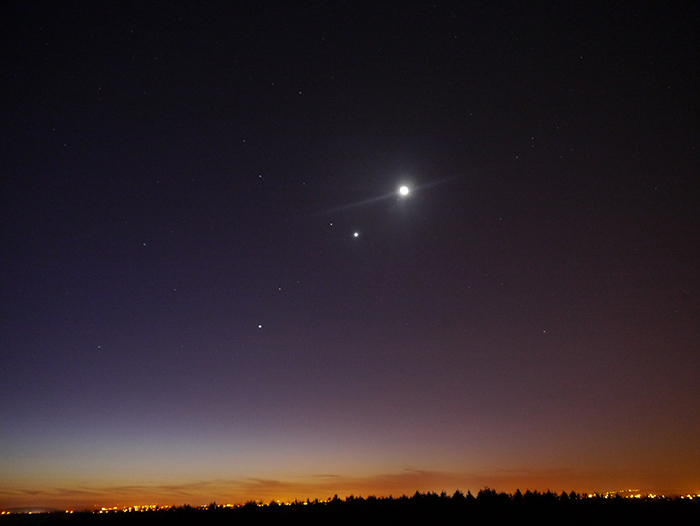 Bright, star-like points of light in the night's sky